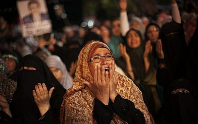 FILE: A supporter of Egypt's ousted President Mohammed Morsi cries during a protest against Egyptian Defense Minister Gen. Abdel-Fattah el-Sissi at Nasr City, where protesters have installed a camp and hold daily rallies, in Cairo, Egypt, Monday, July 29, 2013 (AP/Manu Brabo)