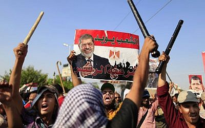 Supporters of Egypt's Islamist President Mohammed Morsi chant slogans during a rally in Nasser City, Cairo, July 4, 2013. (photo credit: AP/Hassan Ammar)