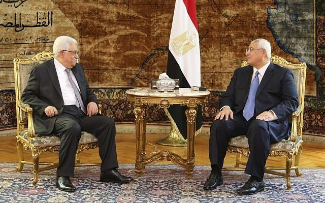 Palestinian President Mahmoud Abbas meets Egyptian interim President Adly Mansour at the Presidential Palace in Cairo, Egypt, on Monday, July 29, 2013. (photo credit: AP/Mohammed Samah, Egyptian Presidency)