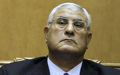 Adly Mansour listens to a speech during his swearing in as Egypt's interim president, on July 4, 2013 (photo credit: AP/Amr Nabil/File)