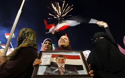 Supporters of Egypt's Islamist President Mohammed Morsi attend a rally in Nasser City, in Cairo, Egypt, Egypt, Monday, July 1, 2013 (photo credit: AP/Amr Nabil)