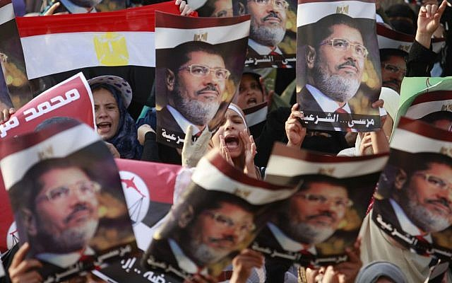 Supporters of the ousted President Mohammed Morsi demonstrate in Nasr City, a suburb of Cairo, Egypt, on Monday, July 8, 2013. (photo credit/Nasser Shiyoukhi/AP)