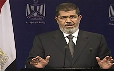 Egyptian President Mohammed Morsi addresses the nation in a televised speech on Tuesday, July 2. (photo credit: AP Photo/Egyptian State Television)
