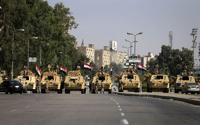 Egyptian soldiers secure the area around Nasser City, where Muslim Brotherhood supporters have gathered to support ousted president Mohammed Morsi, in Cairo Thursday, July 4, 2013. (photo credit: AP/Hassan Ammar)
