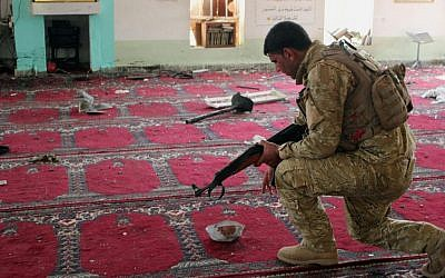 An Iraqi army soldier inspects the damage inside the Abu Bakr Mosque in Baqouba, northeast of Baghdad, Iraq, Friday, July 19, 2013 (photo credit: AP)