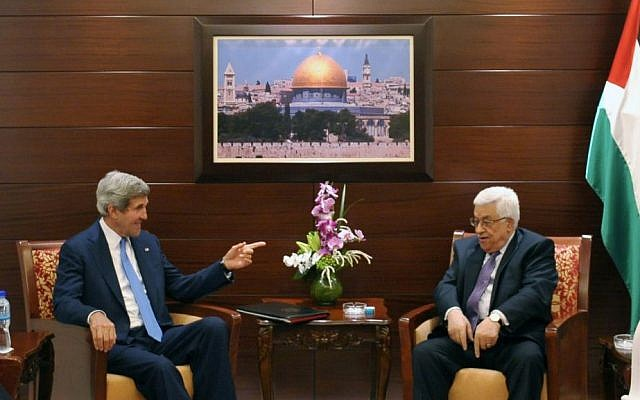 US Secretary of State John Kerry, center left, meets with Palestinian President Mahmoud Abbas on Friday, July 19, 2013 in the West Bank city of Ramallah (photo credit: AP/Mandel Ngan, Pool)