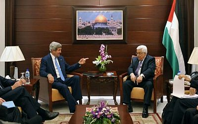 US Secretary of State John Kerry, center left, meets with Palestinian President Mahmoud Abbas, center right, on Friday, July 19, 2013 in the West Bank city of Ramallah. (photo credit: AP/Mandel Ngan)