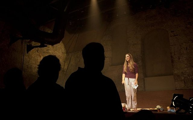 In this photo taken Sunday, July 7, 2013. Israeli actress Sivane Kretchner plays American activist Rachel Corrie as she performs in a theater in Jerusalem. (photo credit: AP Photo/Sebastian Scheiner)