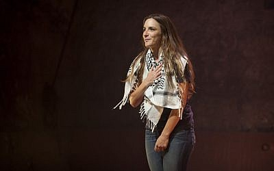 In this photo taken Sunday, July 7, 2013, Israeli actress Sivane Kretchner plays American activist Rachel Corrie as she performs in a theater in Jerusalem. (photo credit: AP Photo/Sebastian Scheiner)