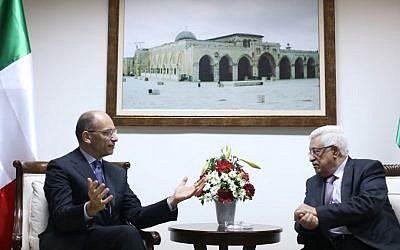Palestinian Authority President Mahmoud Abbas, right, meets with Italian Prime Minister Enrico Letta upon his arrival in the West Bank city of Ramallah Tuesday, July 2, 2013. (photo credit: AP/Fadi Arouri)