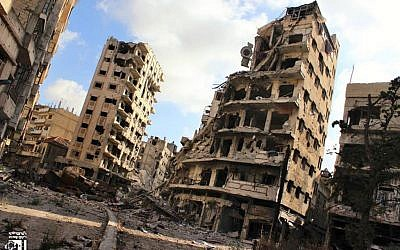 Illustrative photo of buildings damaged by Syrian government airstrikes and shelling, in the Jouret al-Chiyah neighborhood of Homs, Syria, in July 2013. (photo credit: AP/Lens Young Homsi)