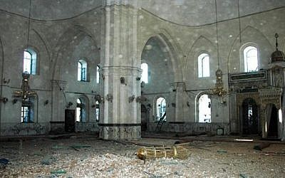 This July 2013 photo released by the Syrian official news agency SANA, shows the inside of the Khalid Ibn al-Walid Mosque in the heavily disputed northern neighborhood of Khaldiyeh, in Homs, Syria. (photo credit: AP Photo/SANA)