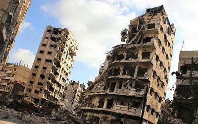 Buildings damaged by Syrian government airstrikes and shelling, in the Jouret al-Chiyah neighborhood of Homs, Syria, July, 2013 (photo credit: AP/Lens Young Homsi)