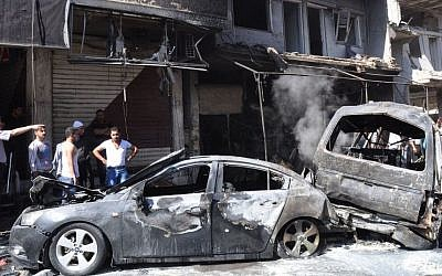 Illustrative photo of a car bombing in Syria (photo credit: AP/SANA)