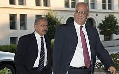 Saeb Erekat, right, Palestinian chief negotiator, and Mohammed Ishtayeh, left, arrive at the State Department in Washington, Monday, July 29, 2013. ( AP Photo/Pablo Martinez Monsivais)