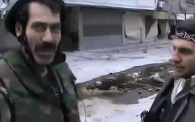 Syrian officer Mustafa Shaddoud seen talking amicably with fighters from the Free Syrian Army (photo credit: YouTube screen capture).
