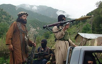 Pakistani Taliban patrol in the tribal region of South Waziristan, 2012. (photo credit: AP/Ishtiaq Mahsud/File)