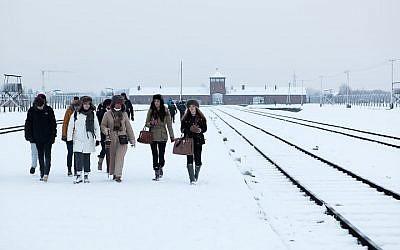 Walking next to the tracks in February. (photo credit: Yakir Zur)