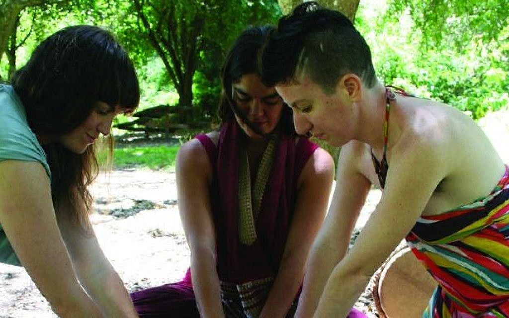 Left to right, Rae Abileah, Taya Shere and Ariel Vegosen performing a ritual to welcome in the summer. (photo credit: Cathleen Maclearie/ via JTA)