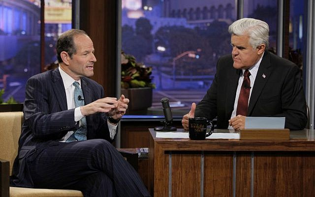 This publicity image released by NBC shows former New York Gov. Eliot Spitzer, left, talking with host Jay Leno during a taping of 'The Tonight Show with Jay Leno,' Friday, July 12, 2013, in Burbank, Calif. (photo credit: AP Photo/NBC, Paul Drinkwater)
