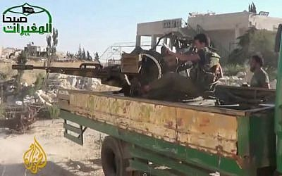 Syrian rebels in Khan al-Assal. (screen capture: Youtube/AlJazeeraenglish)