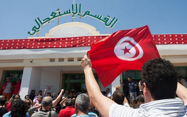 Supporters of the Popular Front party gather at Mahmoud Materi hospital, north of Tunis, in support of Mohammed Brahmi, who was shot to death in his car outside his home, in Tunisia on Thursday, July 25, 2013. (photo credit: AP Photo/Amine Landoulsi)