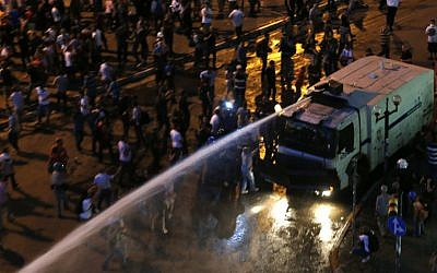 Water cannon sprays protesters during clashes in Istanbul, Turkey, Saturday, June 22, 2013. (photo credit: AP/Petr David Josek)