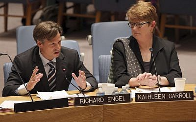 NBC News chief foreign correspondent Richard Engel, left, addresses a United Nations Security Council meeting on the protection of civilians in armed conflict and the protection of journalists, Wednesday, July 17, 2013 at U.N. headquarters. Karhleen Carroll, Associated Press executive editor and vice chair of the board of the Committee to Protect Journalists, listens at right. (photo credit: AP/Mary Altaffer)