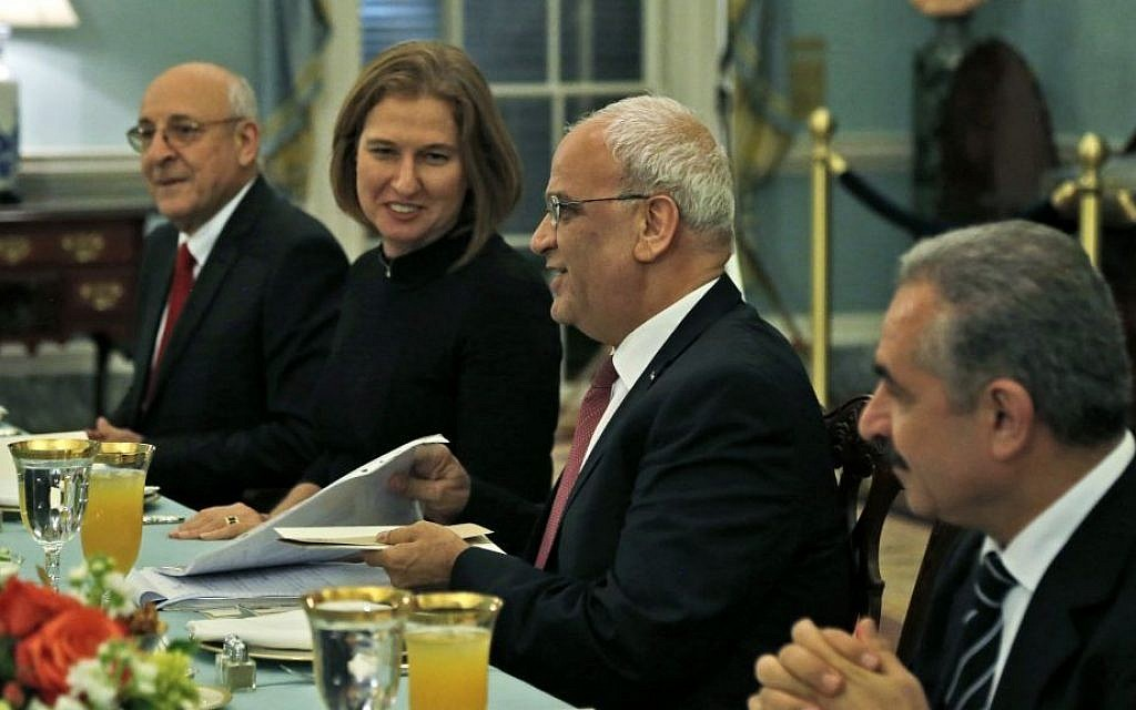 Seated from left to right: Israeli negotiator Yitzhak Molcho, Israeli Justice Minister and chief negotiator Tzipi Livni, Palestinian chief negotiator Saeb Erekat, and Palestinian negotiator Mohammed Shtayyeh, at a dinner marking the resumption of peace talks in Washington, DC on Monday, July 29, 2013. (photo credit: Charles Dharapak/AP)