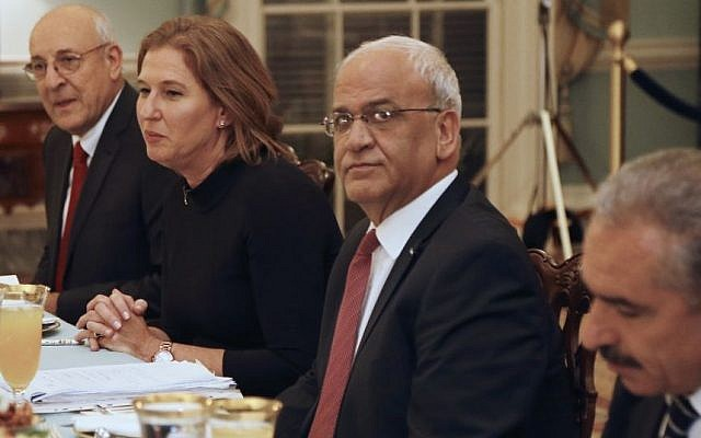 Justice Minister and chief negotiator Tzipi Livni (second from left), Palestinian chief negotiator Saeb Erekat (second from right), Yitzhak Molcho, an adviser to Israeli Prime Minister Benjamin Netanyahu (left) and Mohammed Shtayyeh, aide to Palestinian President Mahmoud Abbas (right), are seated across from Secretary of State John Kerry (not pictured), at an Iftar dinner at the State Department in Washington, July 29, 2013. (photo credit: AP/Charles Dharapak)