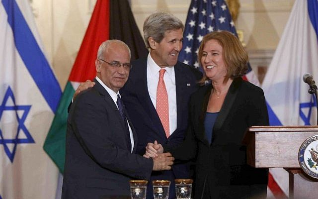 Saeb Erekat, left, with John Kerry, center, and Tzipi Livni at a July press conference in Washington, DC, relaunching peace talks (photo credit: AP/Charles Dharapak)