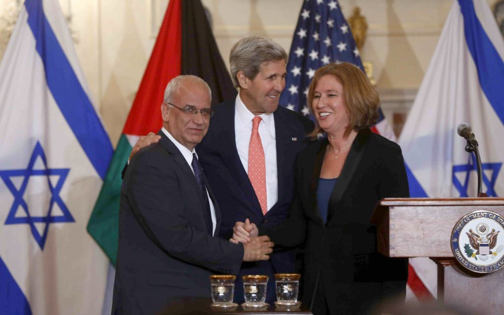 Saeb Erekat, left, John Kerry, center, and Tzipi Livni at a press conference in Washington on Tuesday (photo credit: AP/Charles Dharapak)