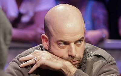 Amir Lehavot checks an opposing player during a hand of Texas Hold'em at the World Series of Poker, Las Vegas. (photo credit: AP/Julie Jacobson)