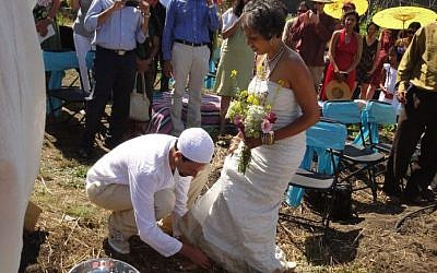 Micha'el BedarShah washes the feet of his bride, Aumatma, during the first wedding ceremony held at Urban Adamah, a Jewish educational farm in Berkeley, Calif., June 30, 2013. (photo credit: courtesy Micha'el BedarShah/JTA)