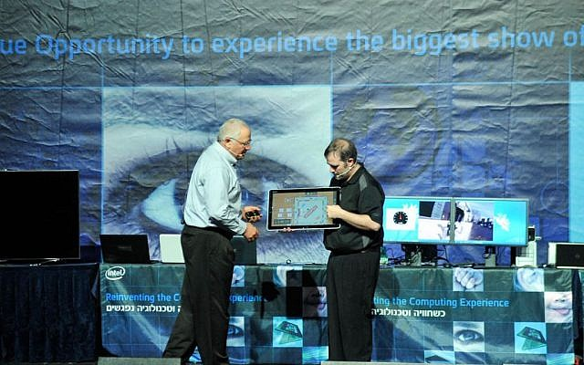 """Yoav Hochberg and Craig, from Intel in Califronia, demonstrate a game of Monopoly on Intel's new full-size """"adaptive"""" desktops (Photo credit: Courtesy)"""