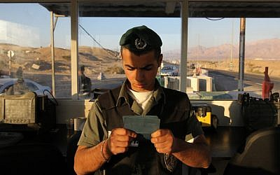 A border policeman checks the id of an individual at the Egyptian border (photo credit: Nati Shohat/Flash90)