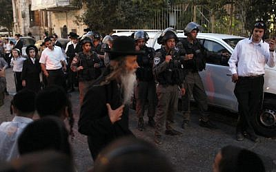 Israeli Border Police officers keep the peace in Jerusalem's Mea Shearim neighborhood on Tuesday, July 9. (photo credit: Flash90)