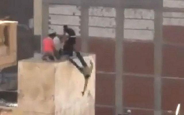 A frame from an illustrative video that shows youths being thrown off a roof during a pro-Morsi protest in Alexandria, Egypt (photo credit: YouTube)