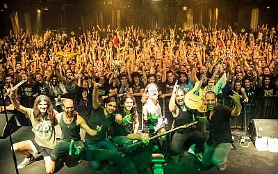 Band members from both Orphaned Land and Khalas at a concert this month promoting their upcoming tour. (Photo credit: Courtesy Kobi Farhi)