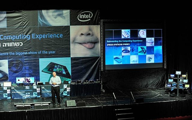 Yoav Hochberg on stage, surrounded by the dozens of new Intel devices presented at the event (Photo credit: Courtesy)