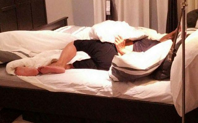 A woman sleeps at IKEA in Netanya after collapsing, apparently drunk, on one of the beds (photo credit: courtesy http://newsil.co.il/)