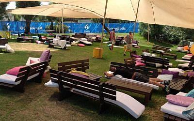 Chilling out at the Hub, the Maccabiah 2013 space for junior athletes (photo credit: Sam Whitefield/Times of Israel)