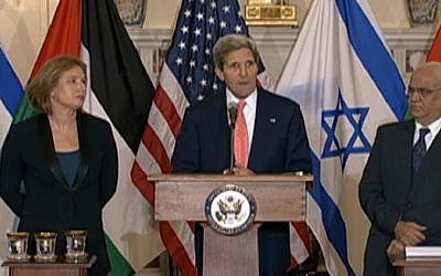 US Secretary of State John Kerry, flanked by Justice Minister Tzipi Livni, left, and Palestinian top negotiator Saeb Erekat, speaking in Washington, July 30, 2013 (photo credit: US State Department))