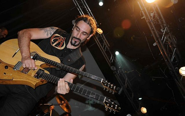 Kobi Farhi on stage with Orphaned Land (photo credit: Asher Kravitz)