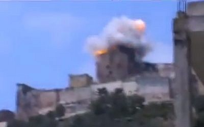 Footage from a video purporting to show the Krak de Chevaliers castle being hit by an airstrike in July 2013. (Screesnhot via YouTube)
