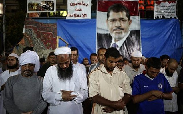Supporters of Egypt's ousted President Mohammed Morsi pray outside Rabaah al-Adawiya mosque, at Nasr City, in Cairo, Egypt, late Tuesday, July 30, 2013 (photo credit: AP Photo/Hassan Ammar)