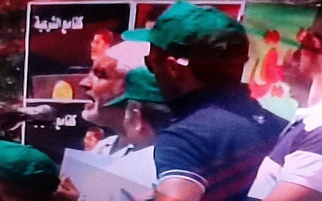 Sheikh Raed Salah (left, in white) speaks at Saturday's pro-Morsi demonstration in Kafr Kanna (photo credit: Channel 2 screenshot)