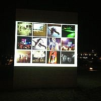 Take an Instagram and see it appear instantly on a giant screen in the Sculpture Garden at the Israel Museum. (photo credit: Jessica Steinberg/Times of Israel)