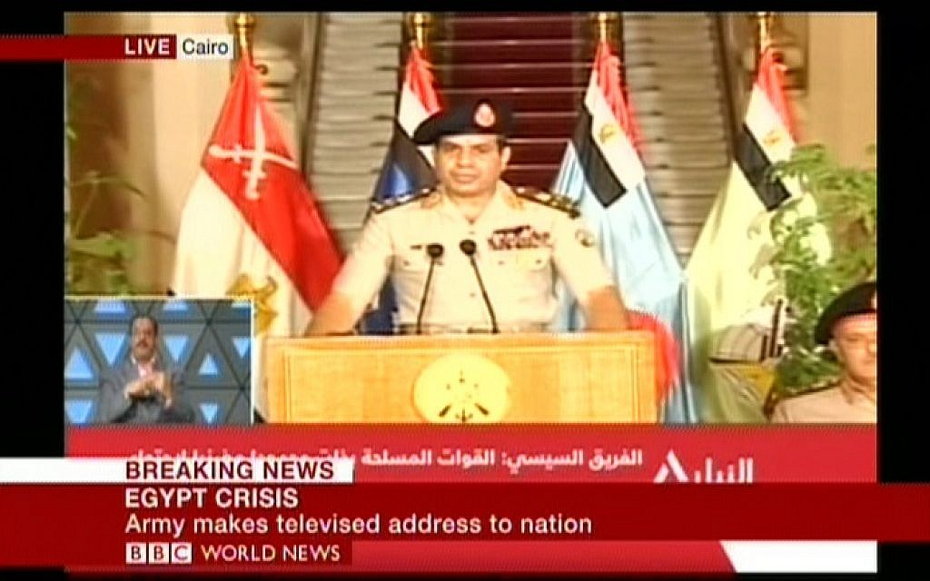 Army chief Abdel-Khatif al-Sissi announcing the army's roadmap Wednesday night. (Screenshot: BBC)