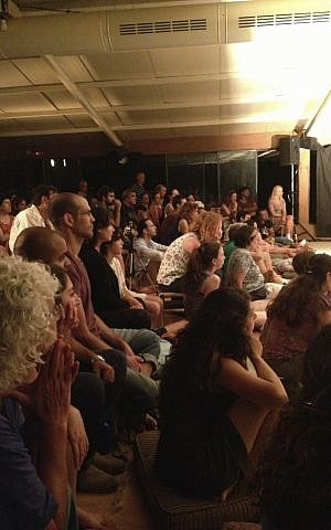 A glance at the mixed Vertigo audience, including members of the dance troupe, their families and locals from the kibbutz where they've set up their own village (photo credit: Jessica Steinberg/Times of Israel)